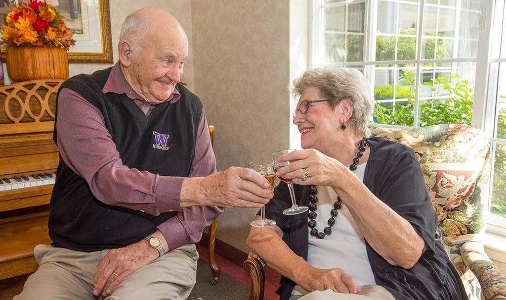 Enjoy a glass of wine with friends at Ashley Pointe, senior living in Lake Stevens, WA