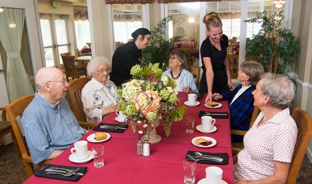 Friends dining together at La Conner Retirement Inn, senior living in La Conner, WA