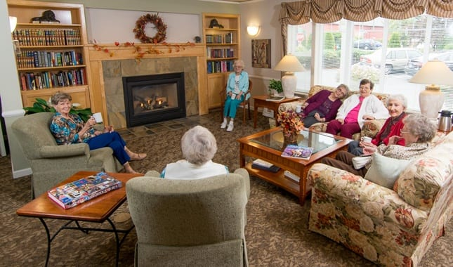 Friends socializing at La Conner Retirement Inn, senior living in La Conner, WA