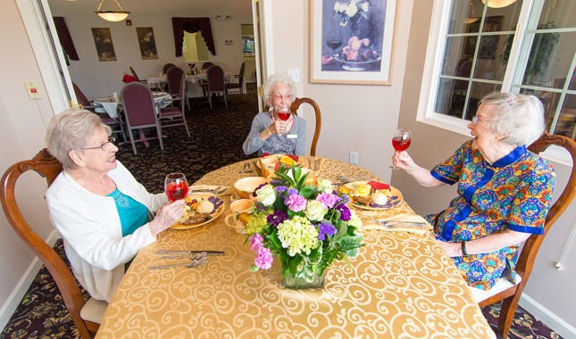Enjoy a glass of wine with friends at South Pointe, senior living in Everett, WA