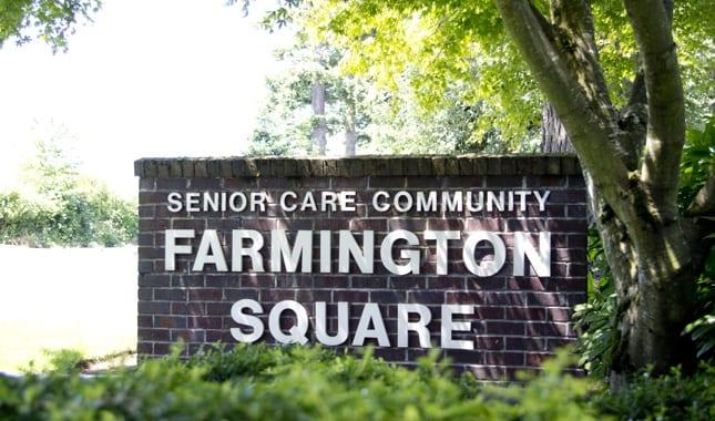 Sign in front of Farmington Square Tualatin, senior living in Tualatin, OR