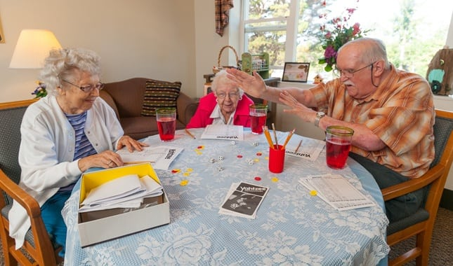 Friends playing Games at Baycrest Village, senior living in North Bend, OR