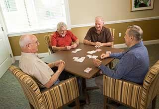 Residents playing cards at Discovery Village At Alliance Town Center in Fort Worth, Texas