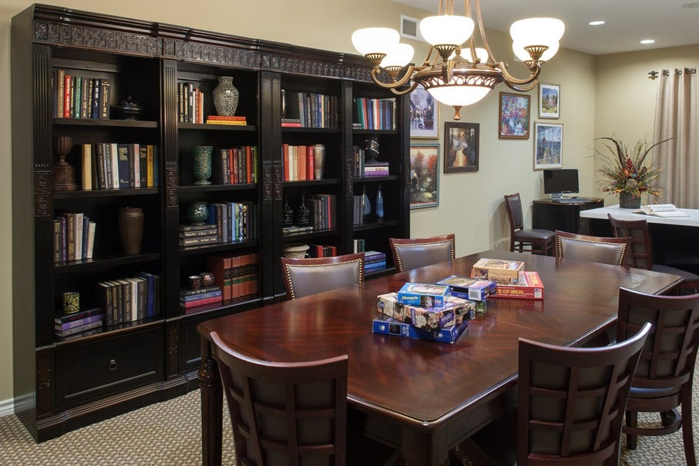 A large community room comes equipped with books and board games for our residents enjoyment