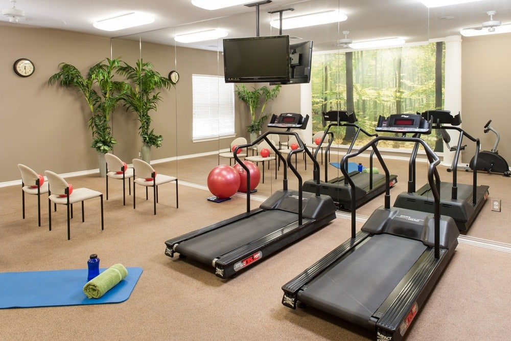 Private fitness room for residents at Senior Living Apartments in Lewisville