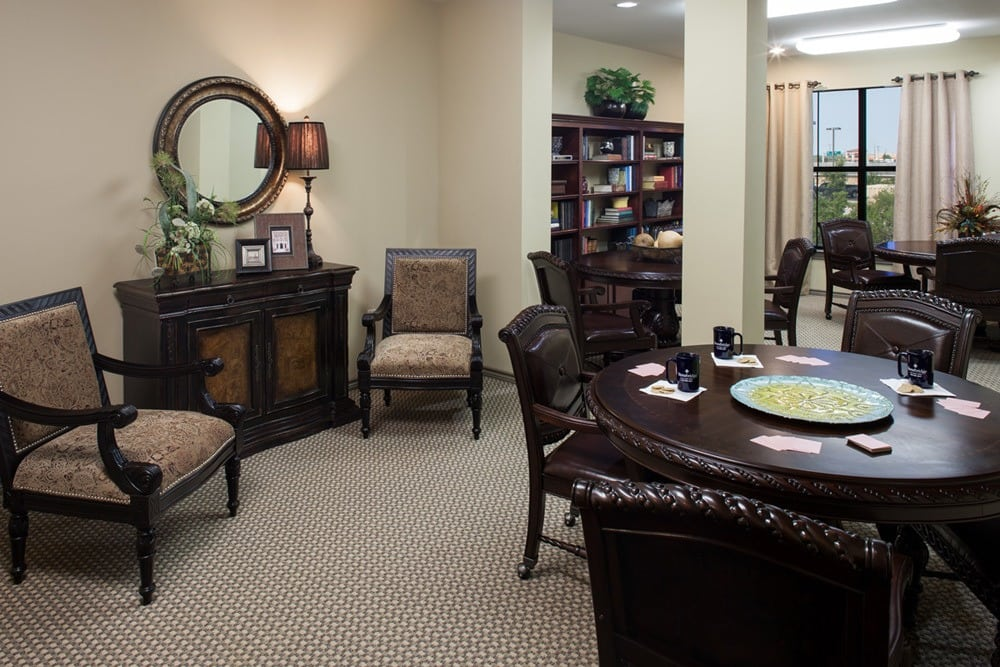 Community seating and tables that enable our residents to socialize comfortably at our apartments in Lewisville