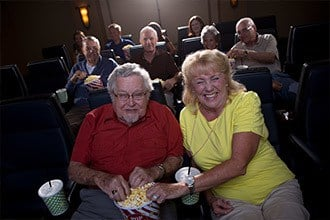 Senior living residents enjoying a film in Melbourne