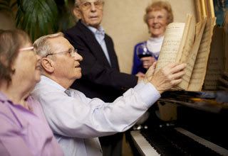 Senior living residents playing music