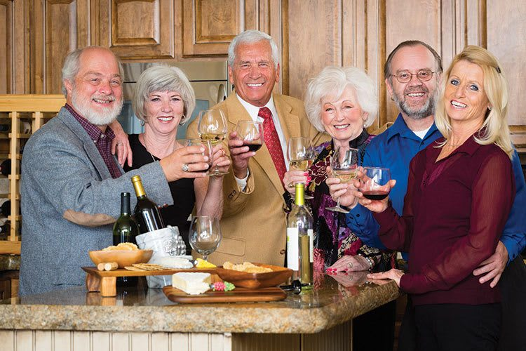 Florida senior living residents socialize at a wine tasting