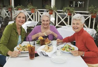 Senior living residents in Florida visiting over lunch