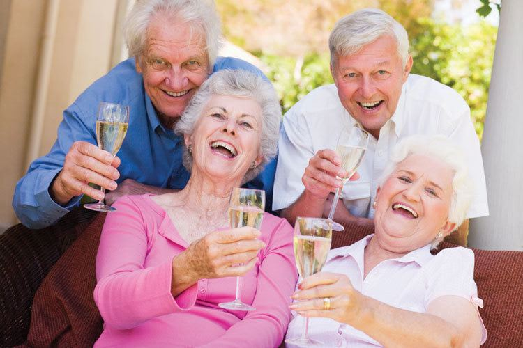 Fort Myers senior living residents celebrate with champagne