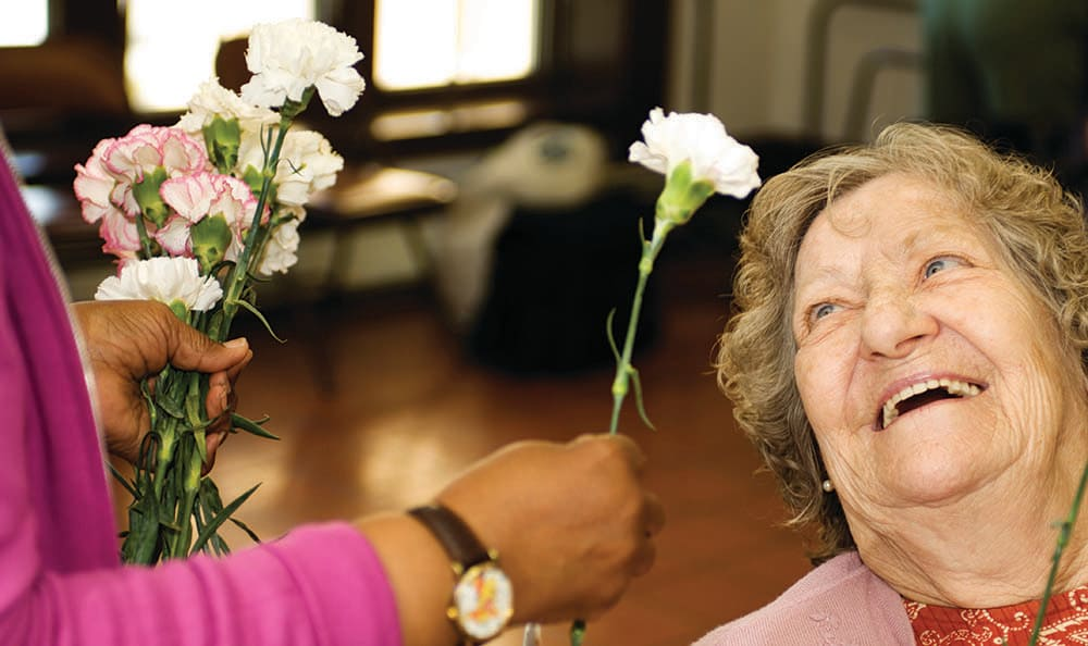 Resident of Fort Myers senior living facility receives flowers