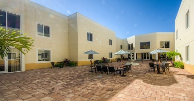 Enjoy the sun in our senior living community's bright, spacious courtyard