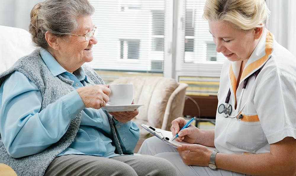 Fort Myers senior living nurse caring for a resident
