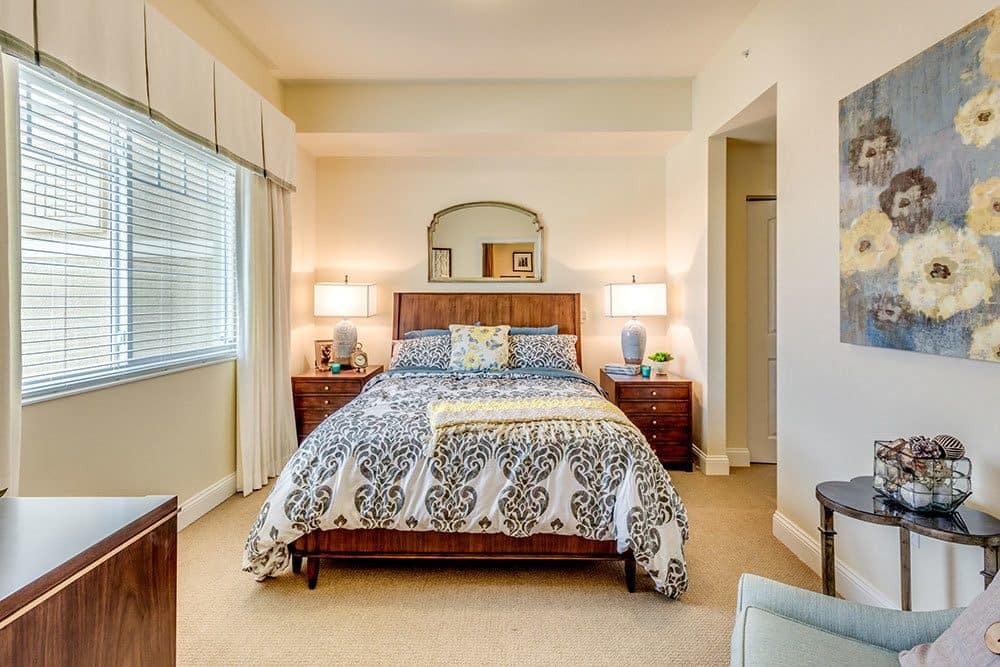 Senior living apartments with bright, cheery bedrooms