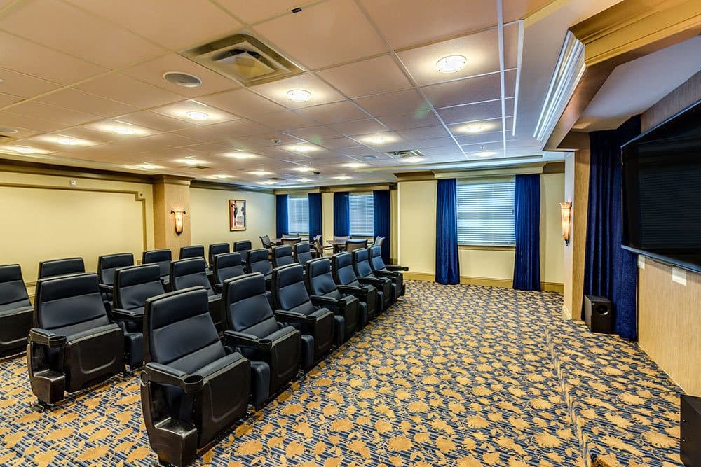 Private movie theater for Naples senior living residents