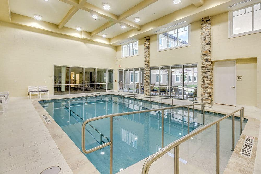 Senior living residents in Naples enjoy a private swimming pool