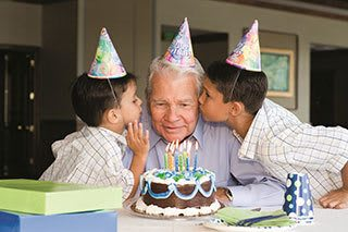 A senior living resident in Tampa celebrates his birthday with relatives