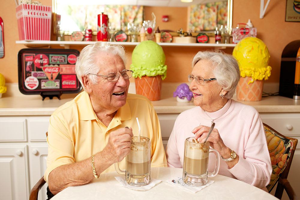 Senior living couple in Palm Beach Gardens enjoying milkshakes