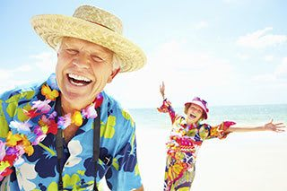 Senior living residents in  having fun at the beach