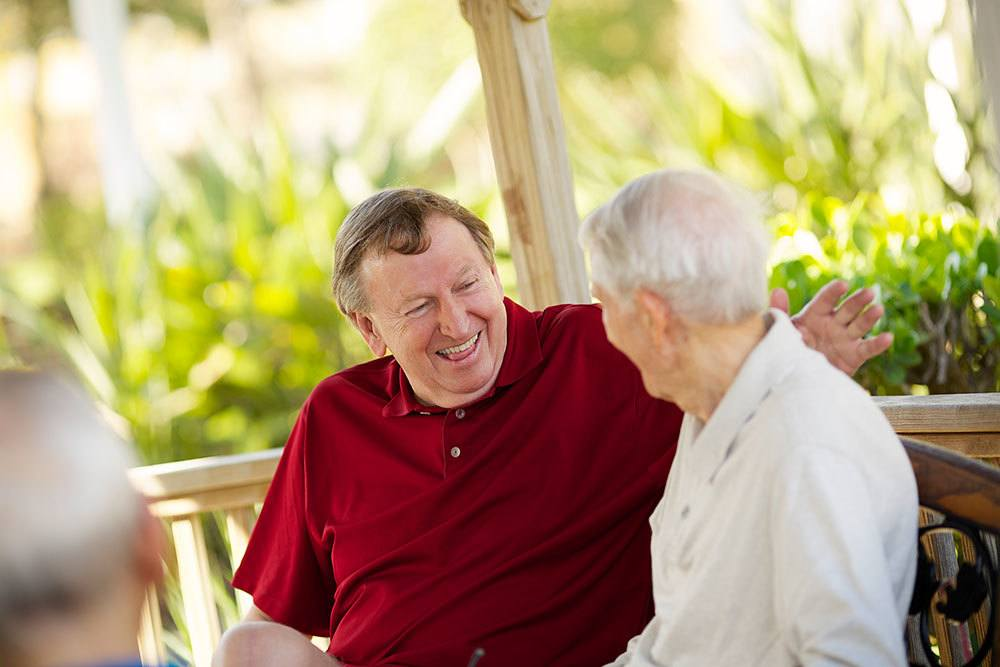 Residents socializing with friends at our Palm Beach Gardens senior living community