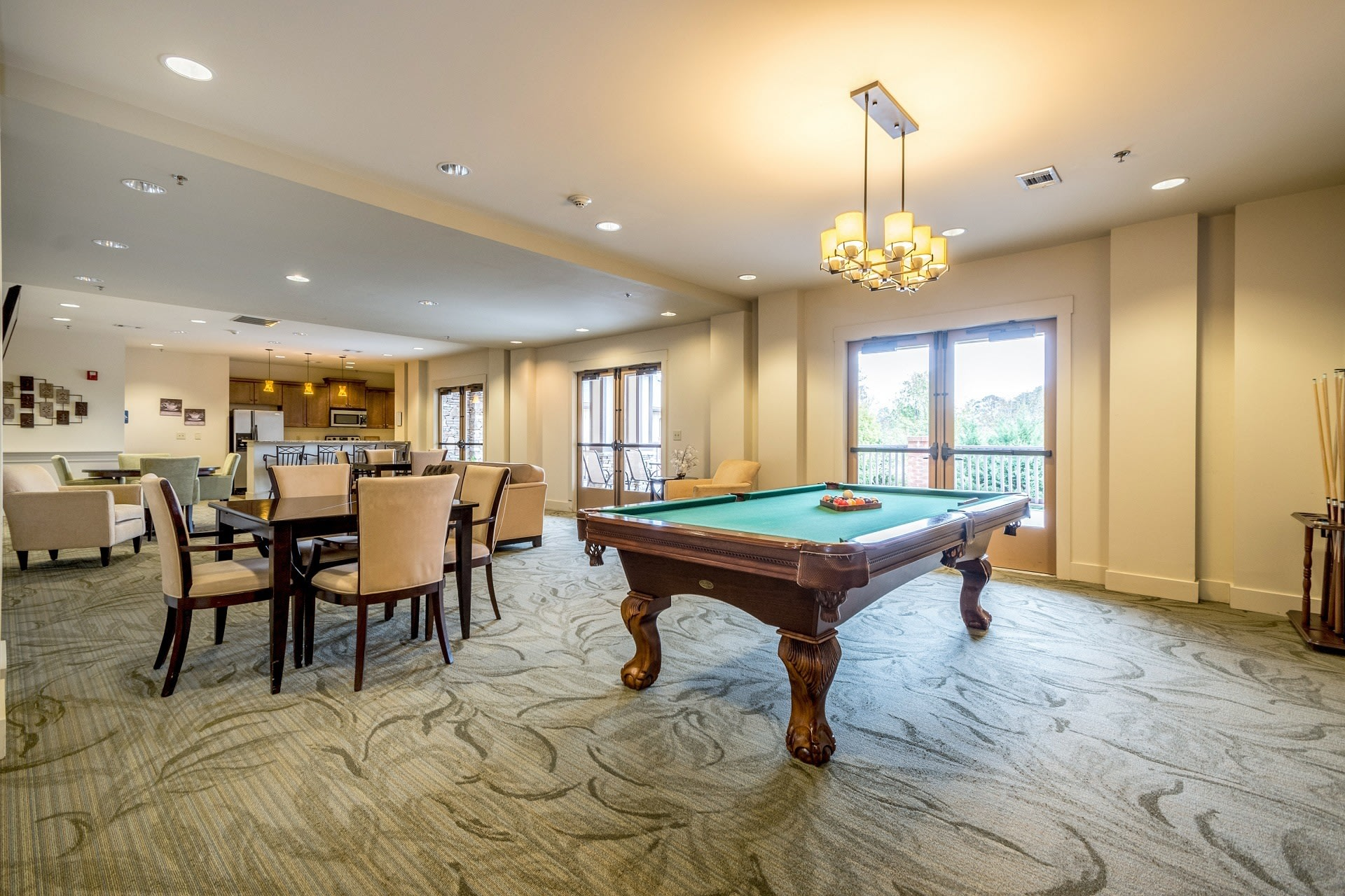 Lots of seating and space to spend time with family and friends at our senior living social room in Suwanee