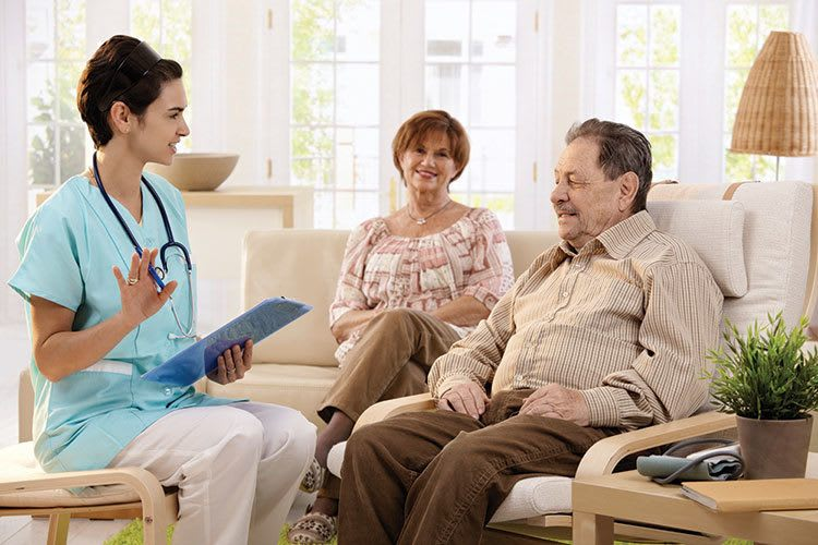 Senior living couple with nurse in Suwanee