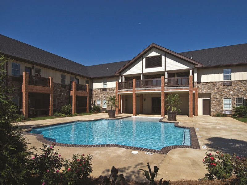 Senior living residents in Suwanee enjoy a resort-style pool
