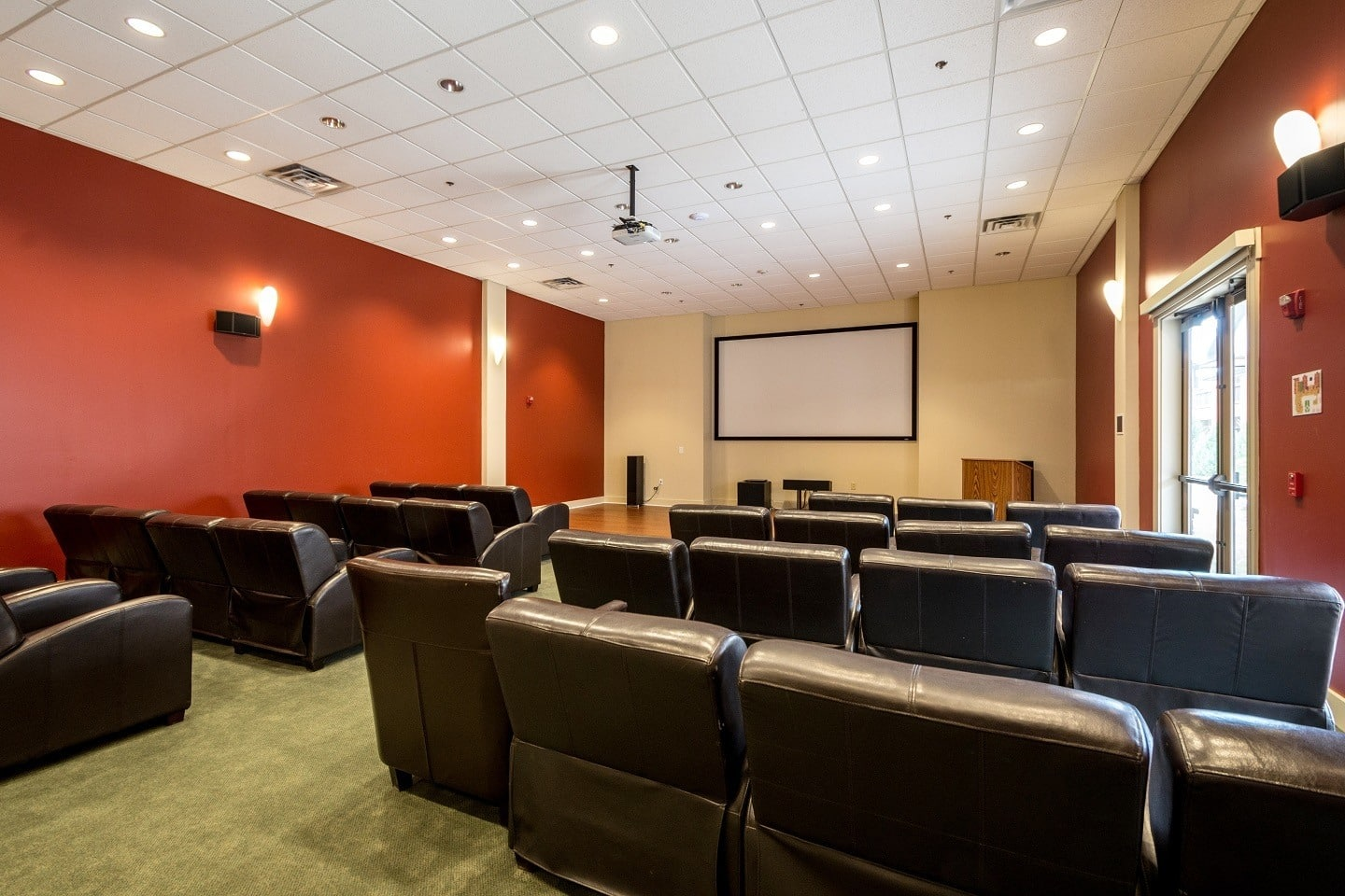 Private movie theater for residents at our Suwanee senior living community