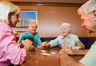 Senior living residents in Allen playing cards