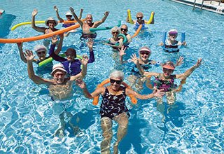 Senior living residents in Allen enjoy pool aerobics games and exercises