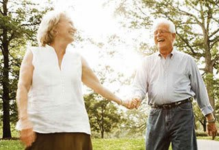 Senior living couple in Allen enjoy a nature walk