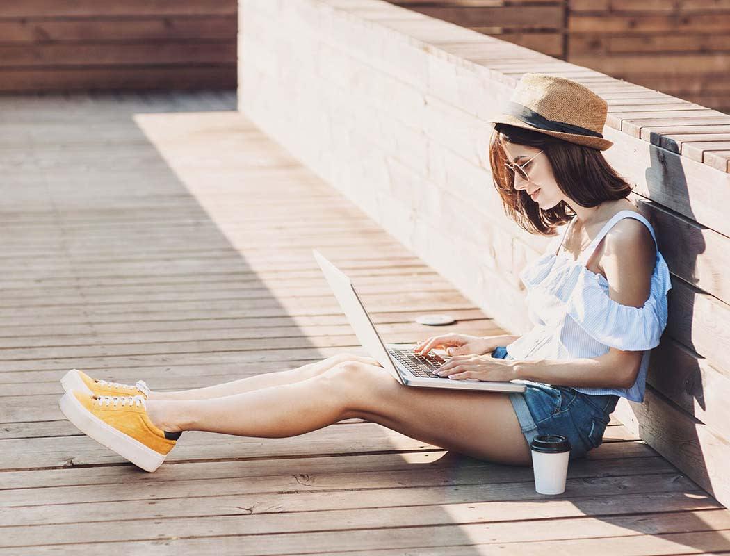Girl working on laptop in Atlanta near Block Lofts