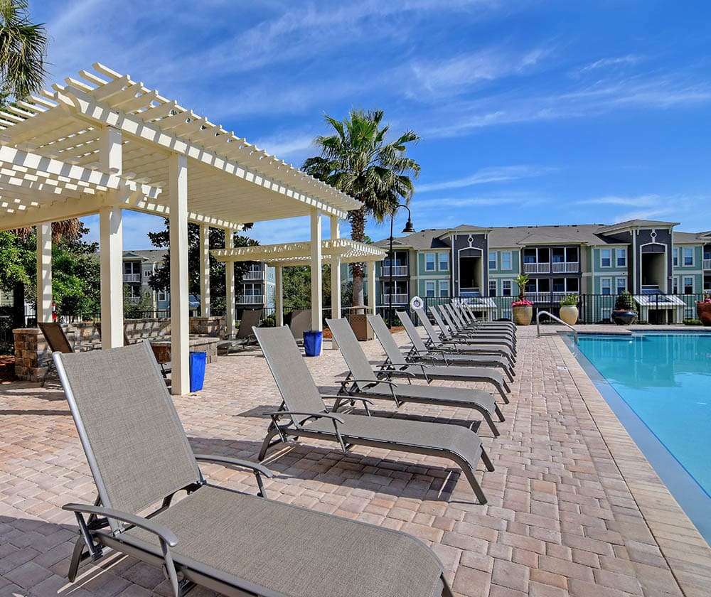 Pool and patio area at The Retreat at PCB in Panama City Beach