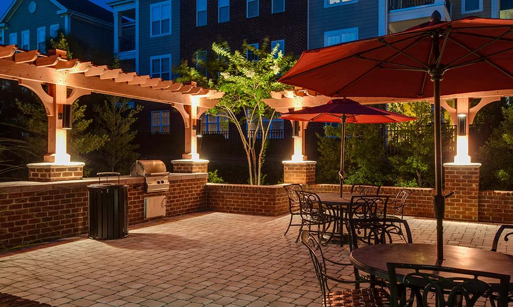 Bbq Area At Night At Legacy at Wakefield In Raleigh