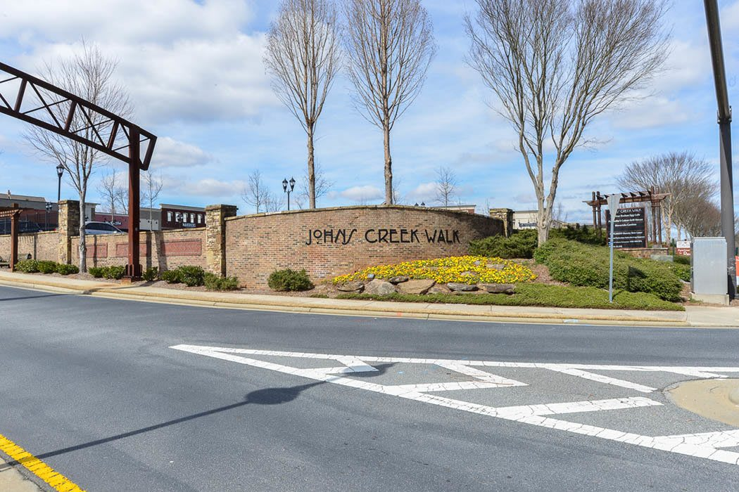 Front sign at The Reserve at Johns Creek Walk in Johns Creek
