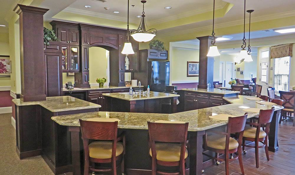 Kitchen with island seating at Benton House of Woodstock in Woodstock, GA