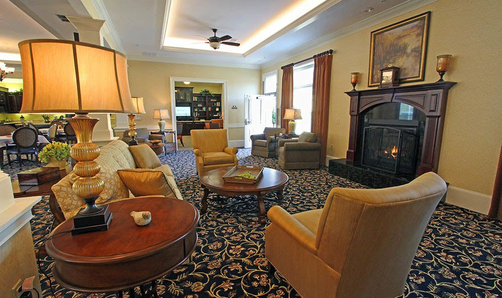 Read a book by the fireplace at Benton House of Tiffany Springs in Kansas City, MO