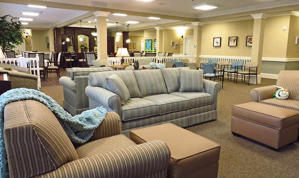 Gathering area with activties at Benton House of Raymore in Raymore, MO