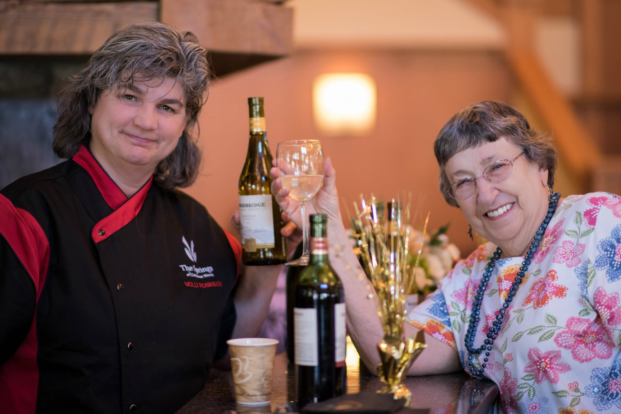 Cheers to living the good life at our senior living facility in Milwaukie, OR