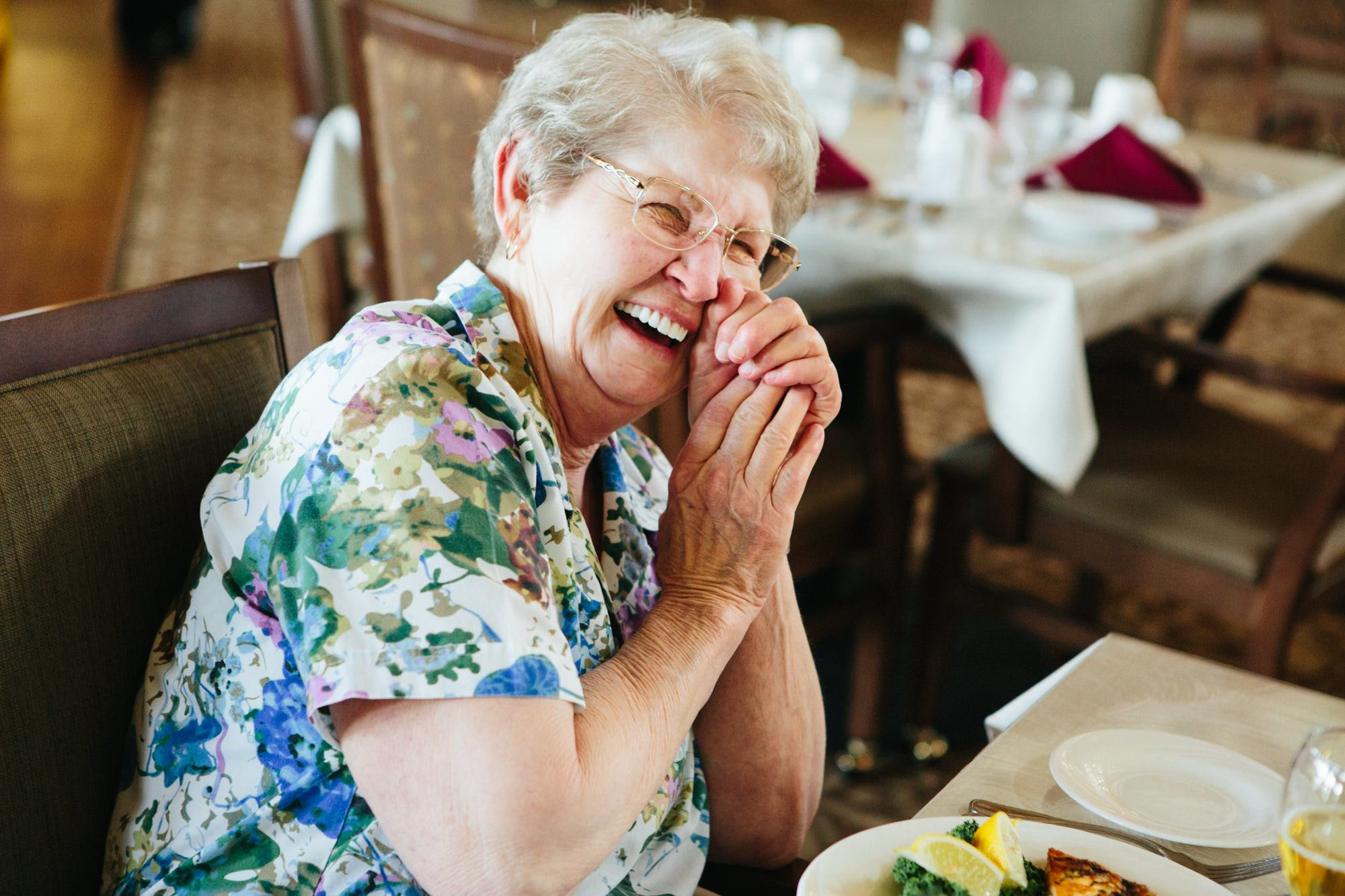 Residents enjoy a meal together in Missoula