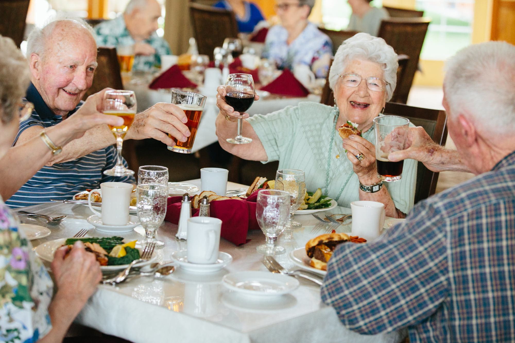 Residents enjoy a meal together in our senior living facility in Missoula, MT