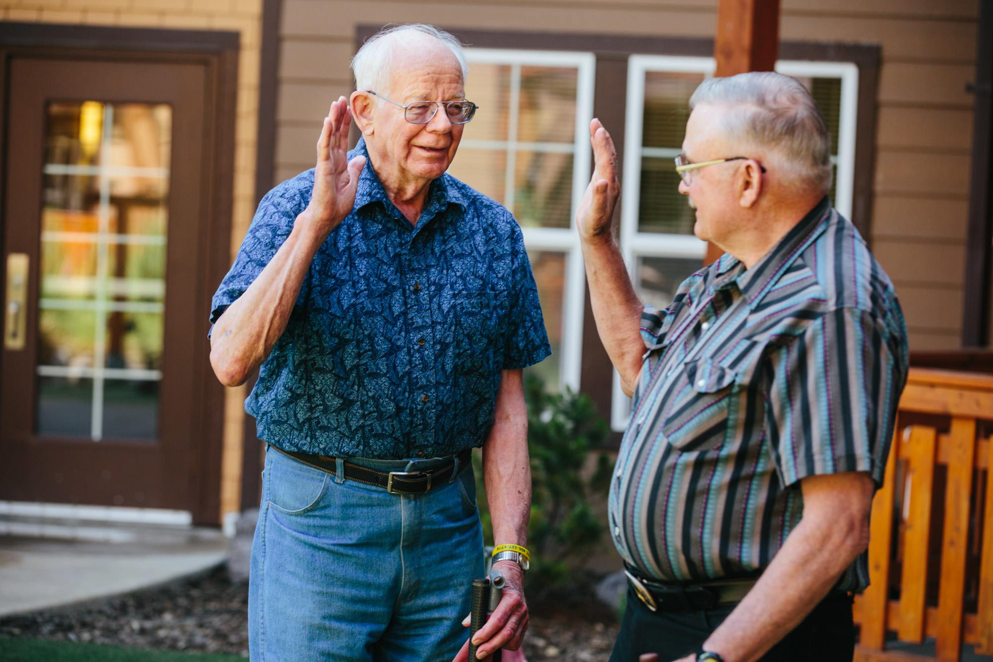 Residents celebrate a round of golf in the courtyard in Missoula