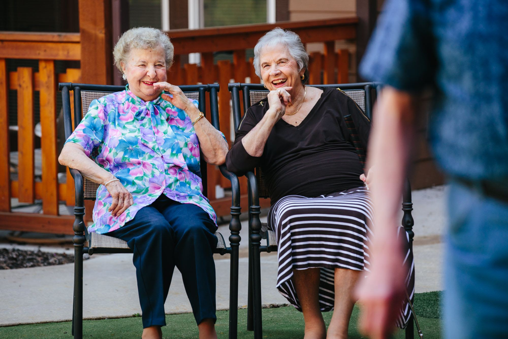 Residents enjoy a moment together on the courtyard in Missoula