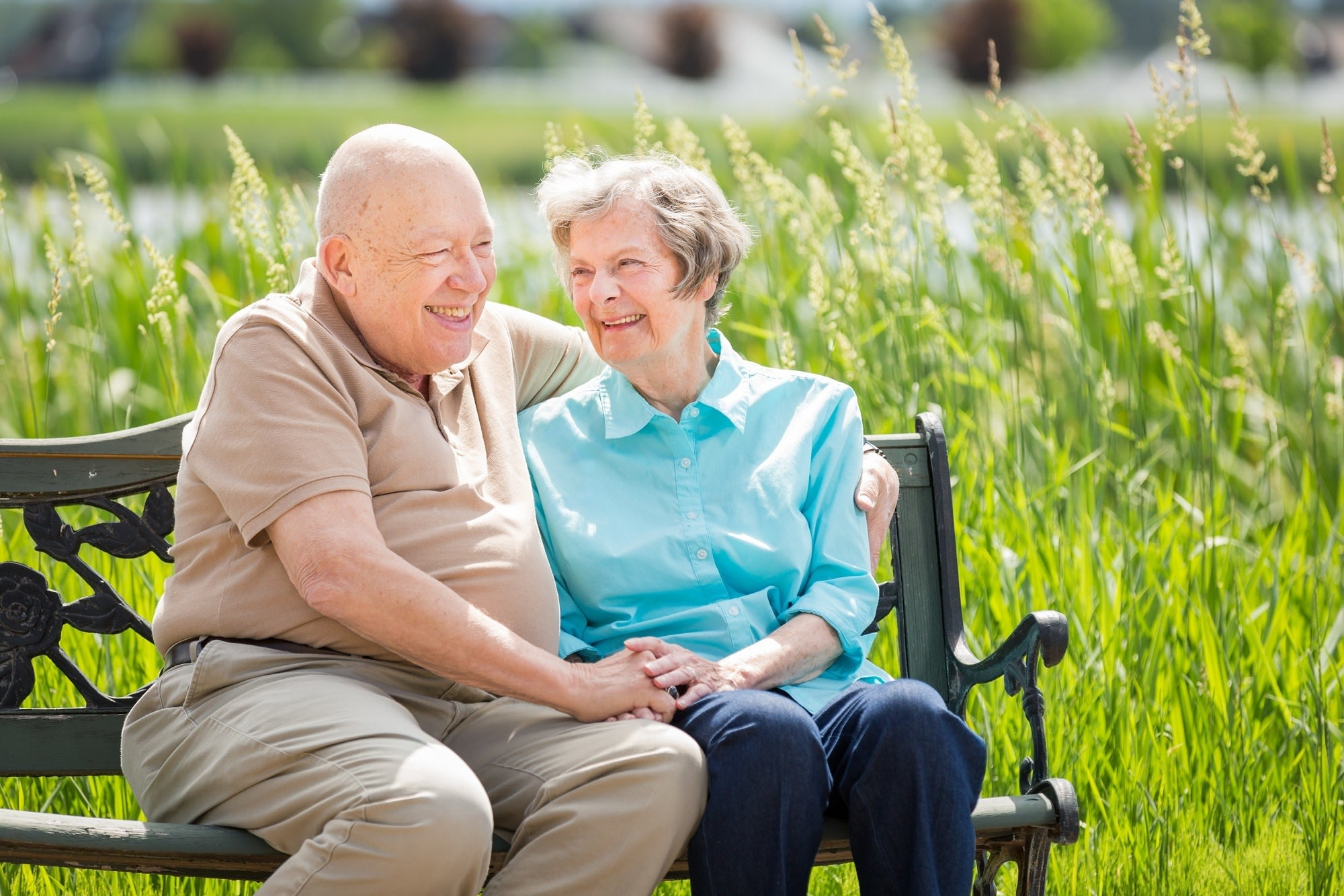 Residents enjoy a sweet moment by the pond in Whitefish