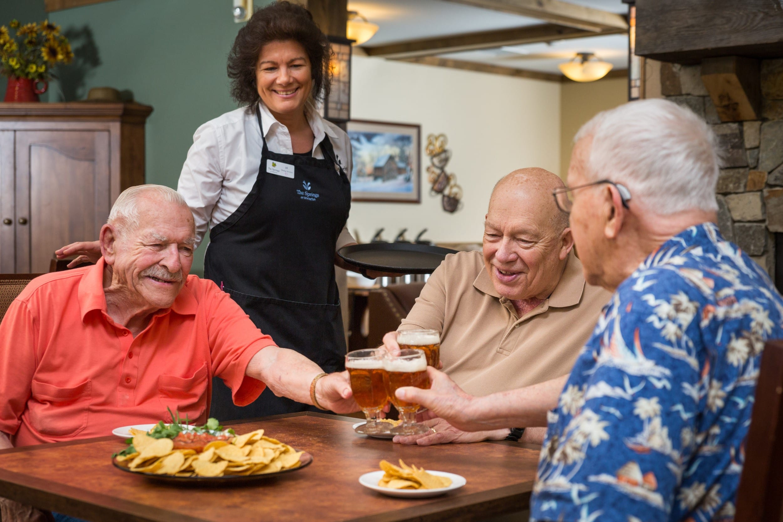 Residents enjoy a drink together at our senior living facility in Whitefish, MT