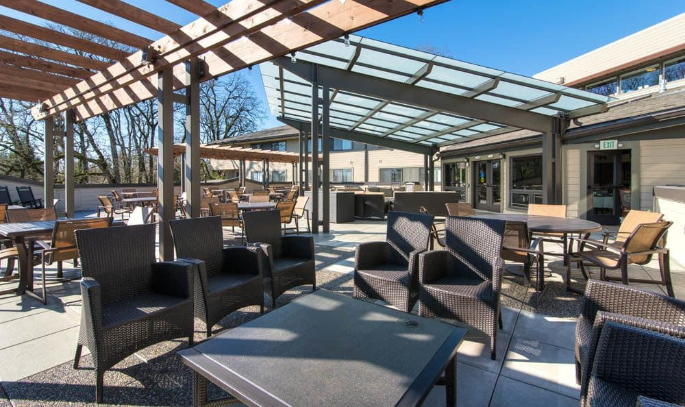 Enjoy the sunlight in our open patio in our senior living facility in Lake Oswego, OR