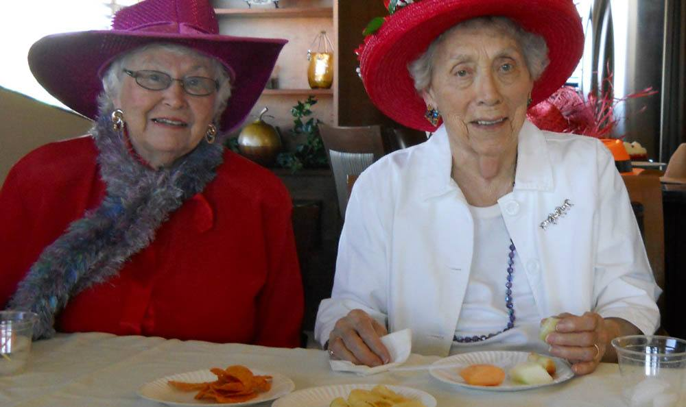 Senior living friends enjoying a party in The Dalles, OR