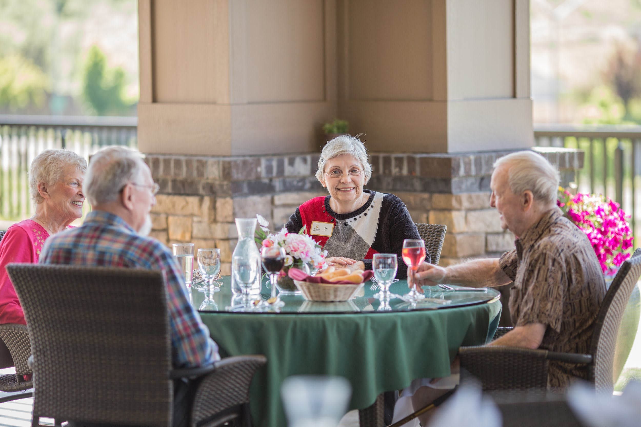 Residents enjoy a meal outside in Medford