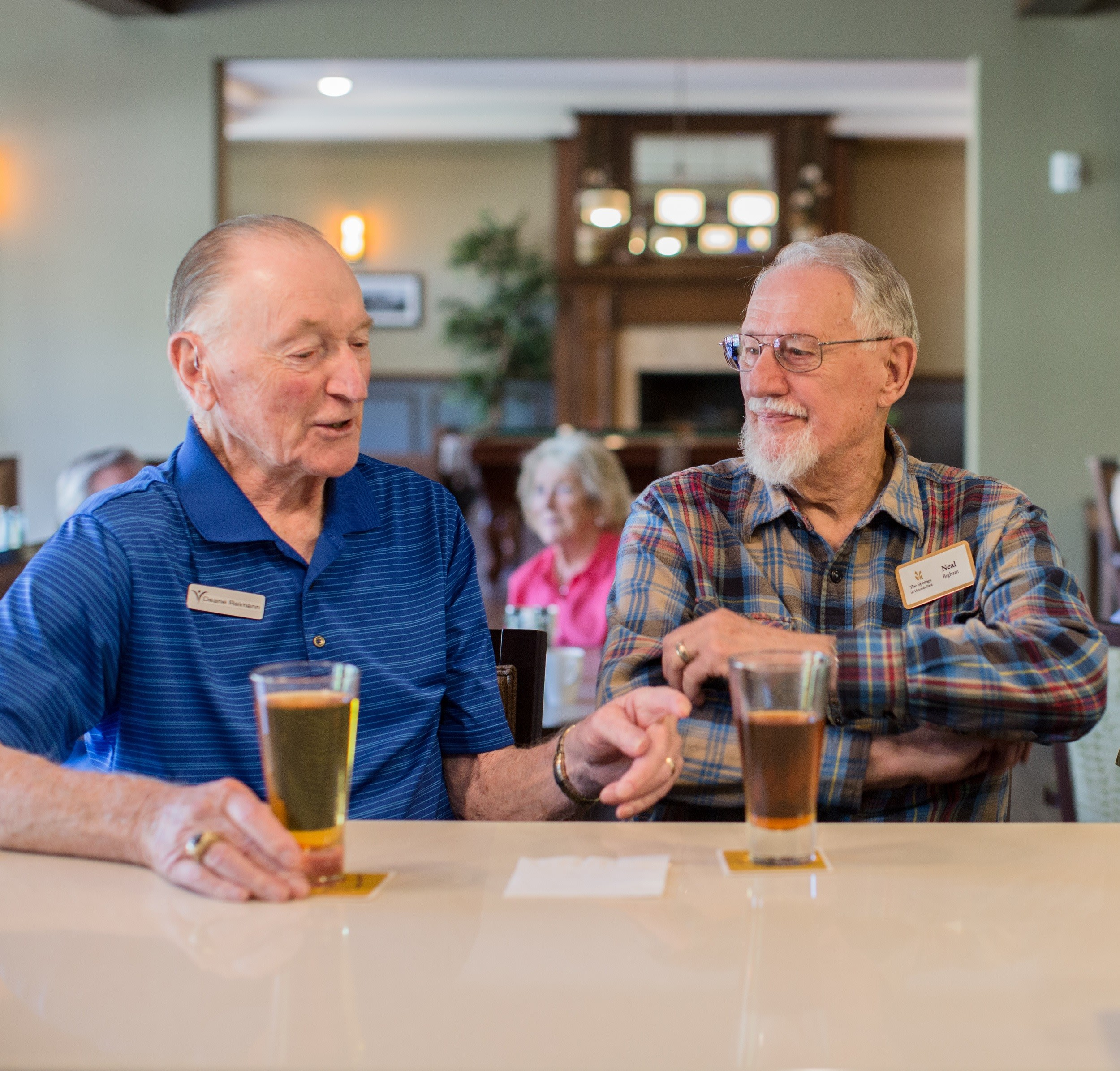 Residents enjoy a drink in the pub in Medford